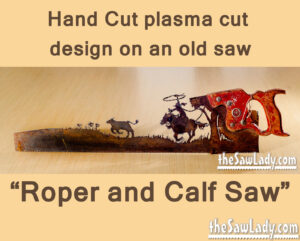 Metal art cowboy roping calf saw