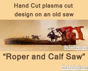 Metal art cowboy roping calf saw