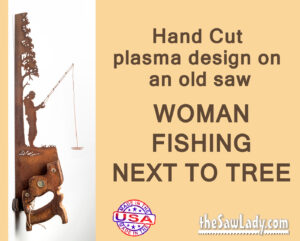 Metal art woman fishing near tree saw