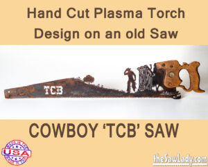 TCB Outhouse Cowboy saw metal art