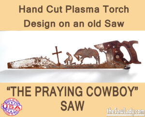 Metal art praying cowboy saw